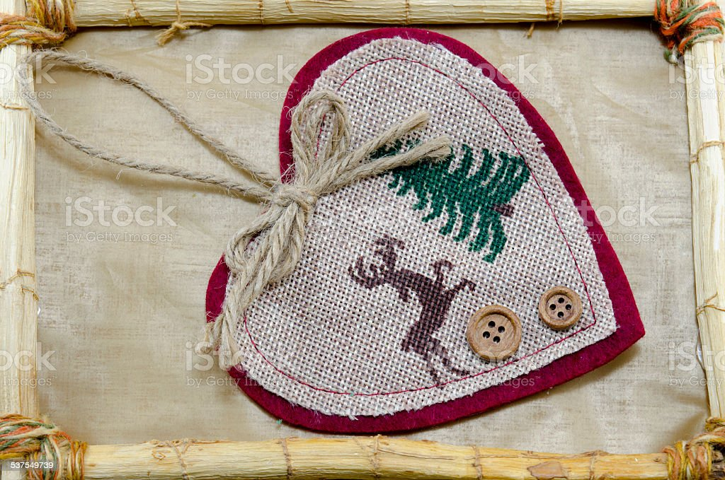 Handmade heart embroidery in a bamboo frame royalty-free stock photo