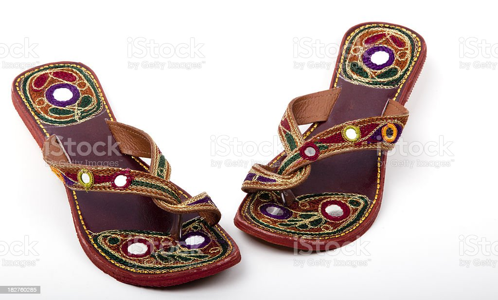 Handmade indian shoes on white stock photo