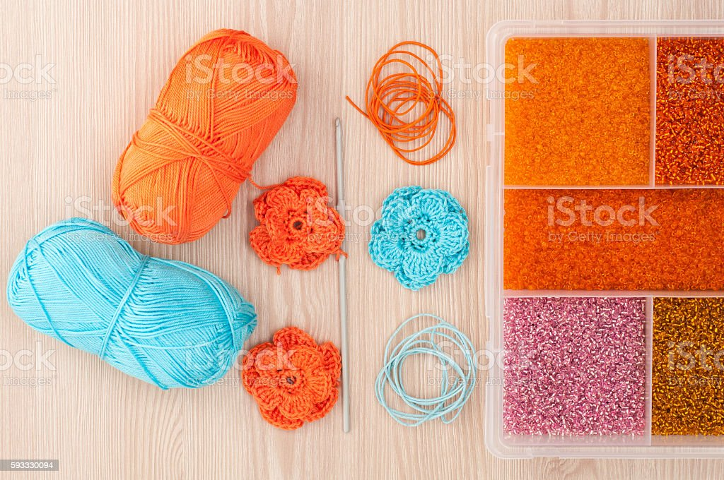 Handmade knitted crochet flowers and box with beads stock photo