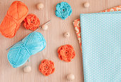 Handmade knitted crochet flowers and wooden beads. Cotton yarn