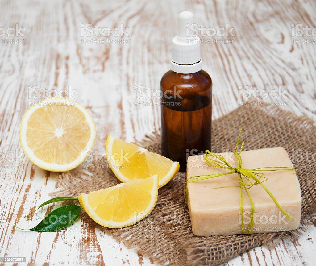 handmade lemon soap and essential oil stock photo