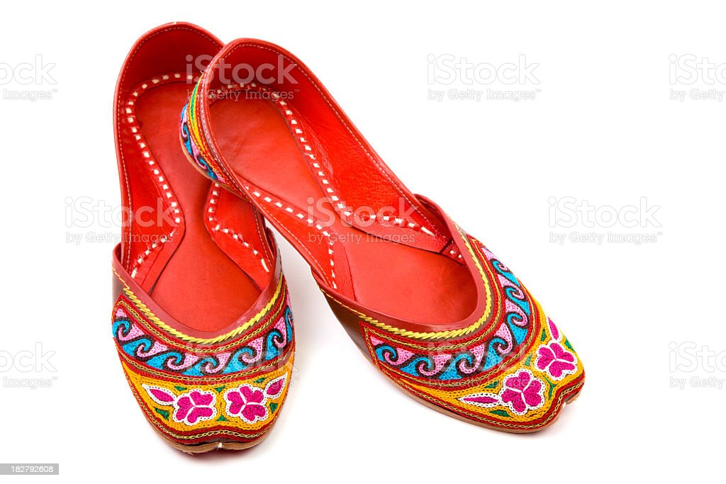 Handmade Multicolored Indian Shoes On White Background stock photo