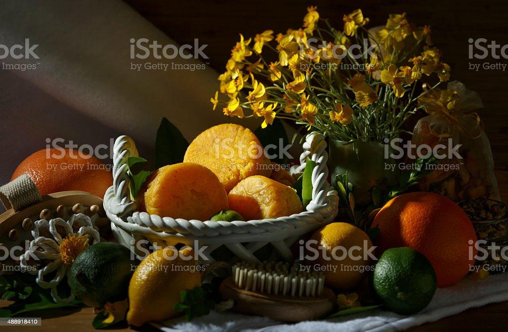 Handmade Natural Citrus Scented Yellow Soap Spa Set Chiaroscuro Lighting royalty-free stock photo