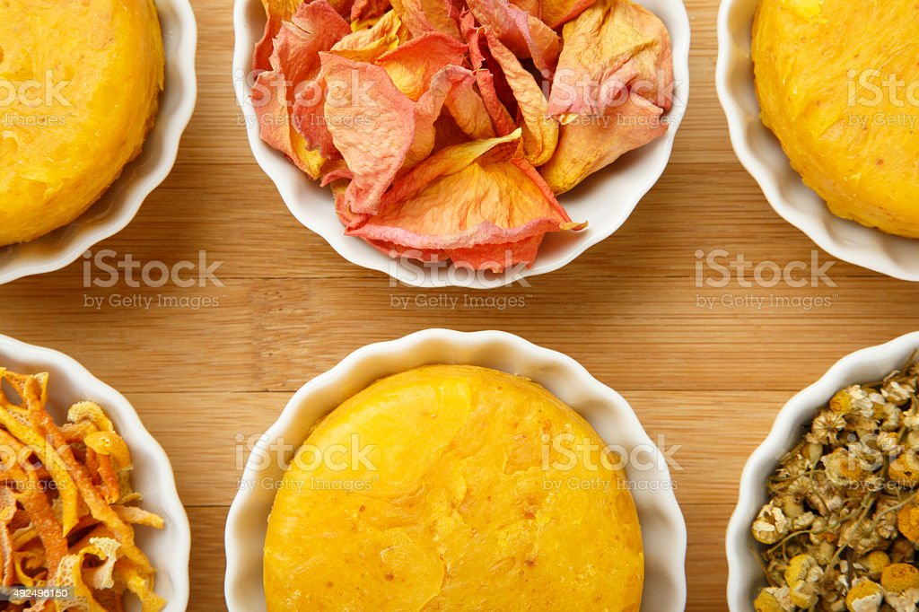 Handmade Natural Yellow Round Soap Creative Product Photography Styling royalty-free stock photo