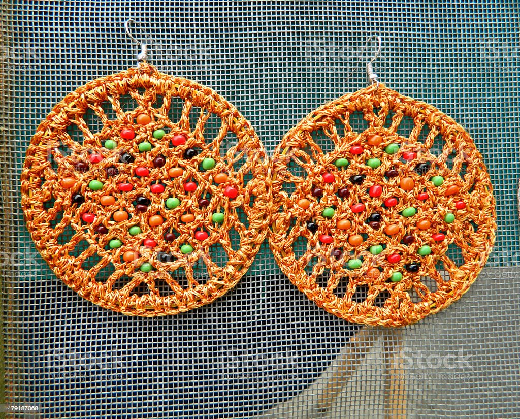 Handmade orange earrings stock photo
