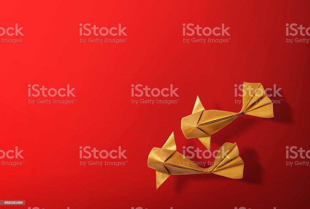 Handmade paper craft gold color origami koi carp fish. stock photo