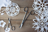 handmade paper snowflakes and scissors