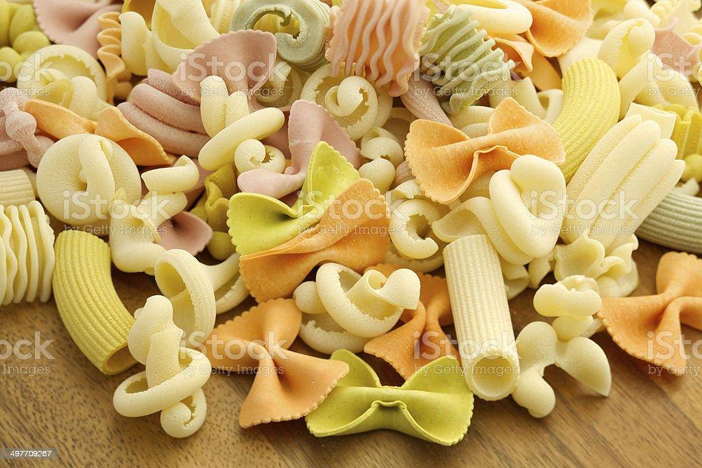 Handmade pasta with random shapes on wood royalty-free stock photo