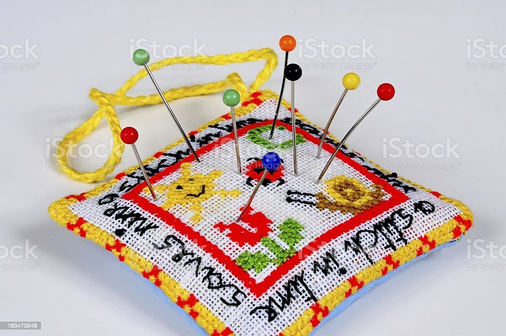 Handmade pincushion with pins. stock photo