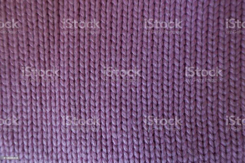 Handmade pink plain stockinette fabric from above stock photo