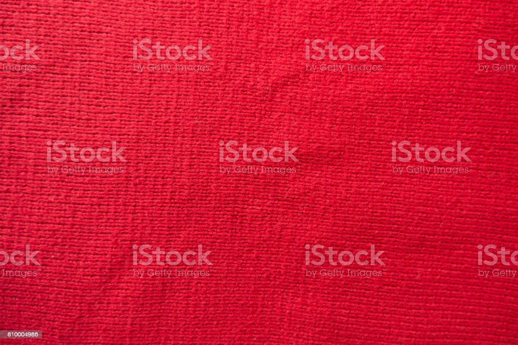 Handmade plain red stockinette fabric from above stock photo