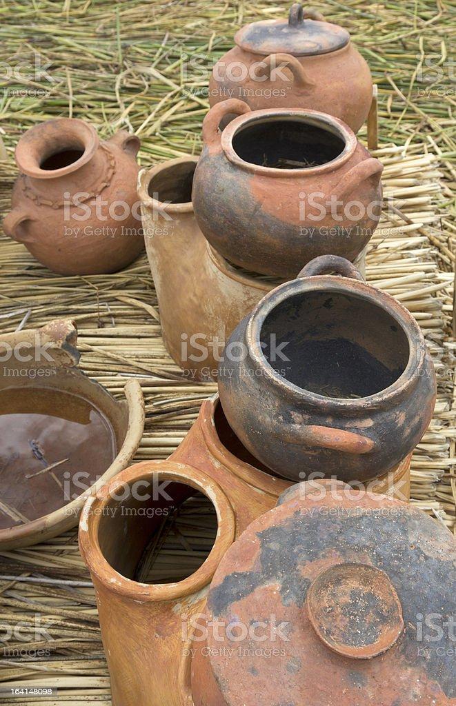 Handmade pots on a floating island Uros royalty-free stock photo