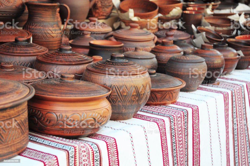 Handmade pottery. Traditional Ceramic Jugs. Handmade Ceramic Pottery with Ceramic Pots and Clay Plates. stock photo