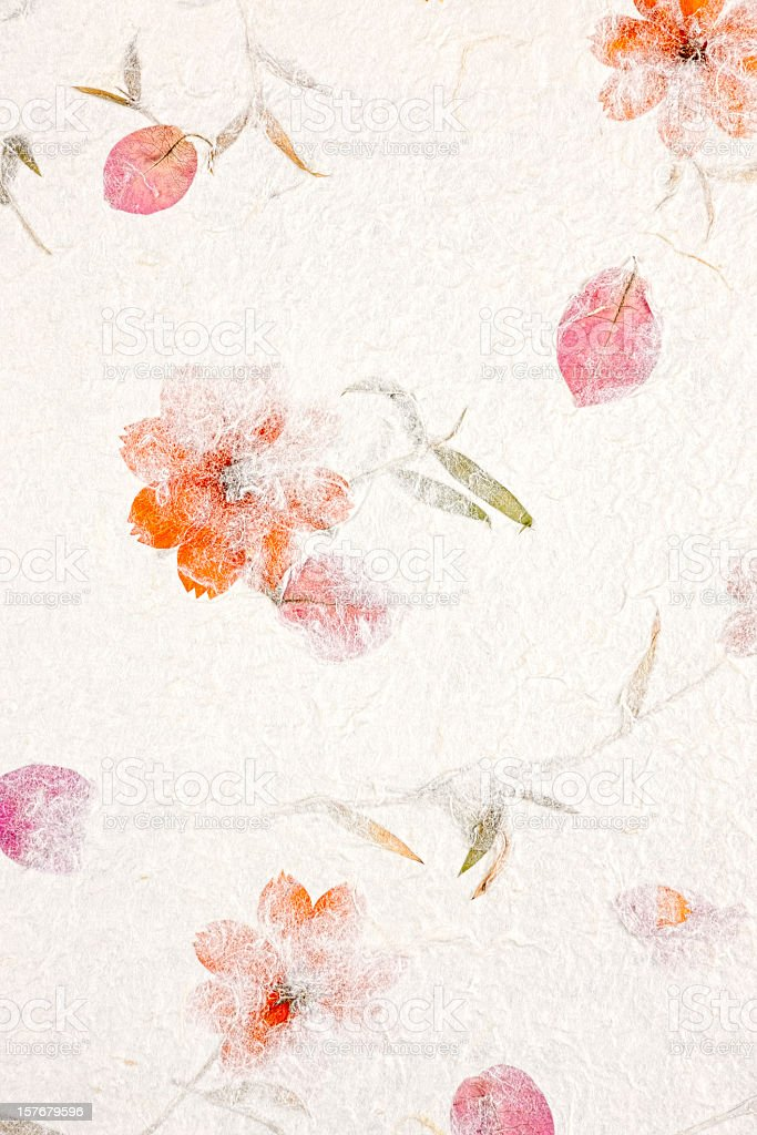 Handmade recycled flower and leaf paper background. stock photo