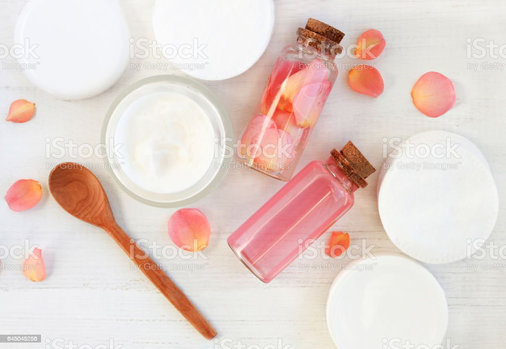 Handmade rose extract cosmetic products with fresh flowers. stock photo