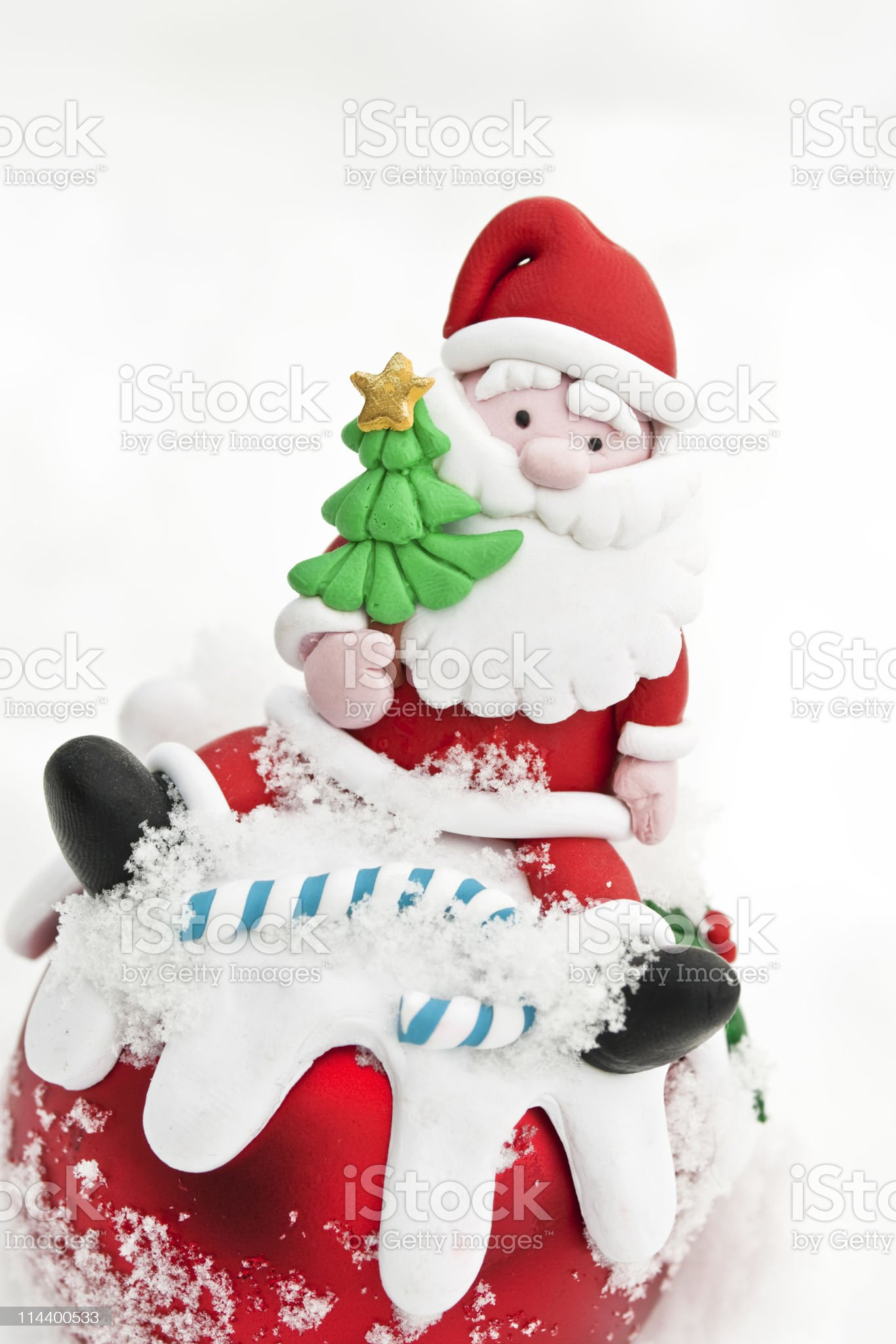 Handmade santa christmas decoration on real snow background royalty-free stock photo