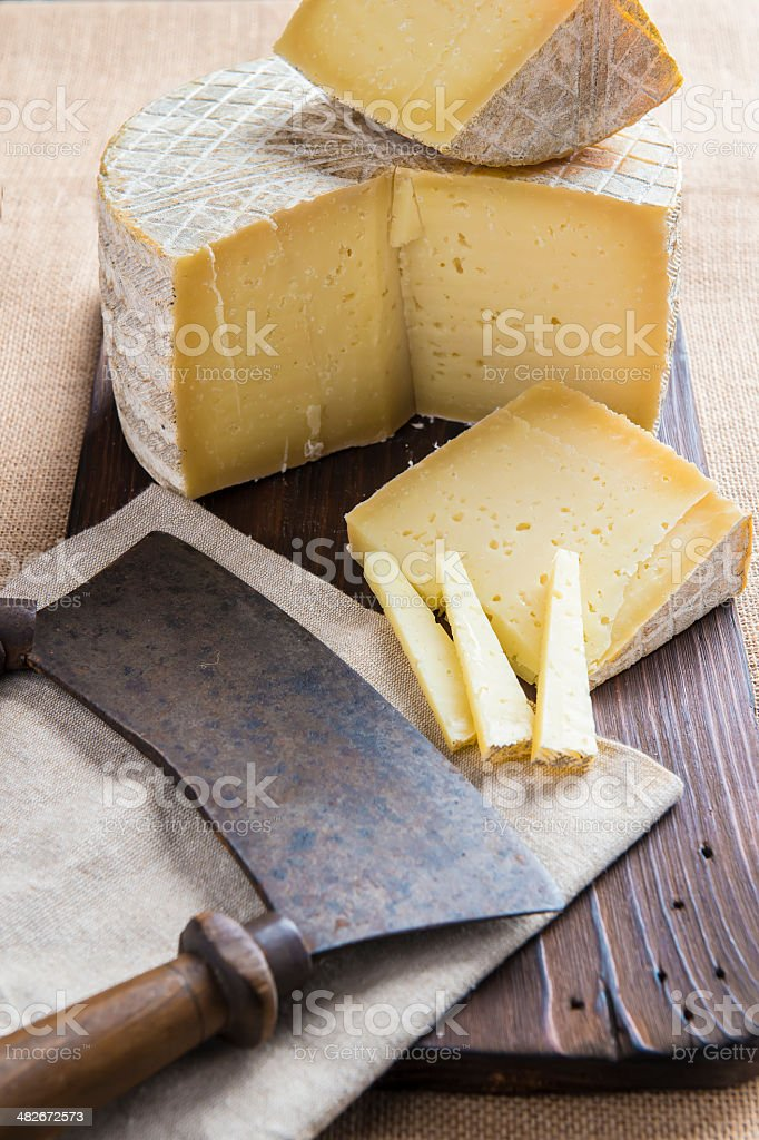 Handmade sheep cheese on the cutting board royalty-free stock photo