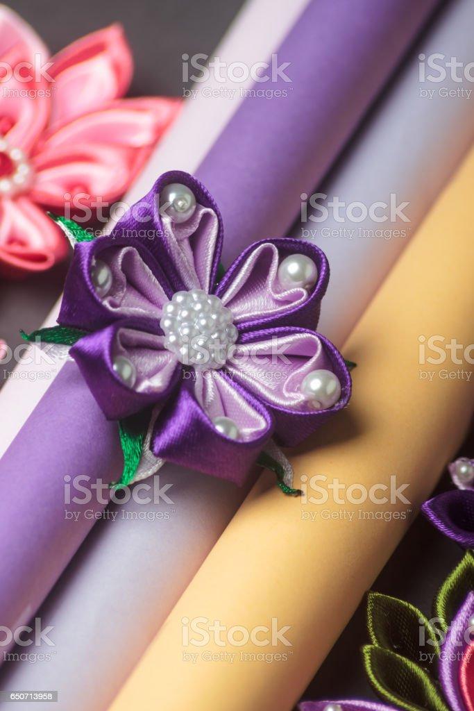 Hand-made silk fabric flowers stock photo