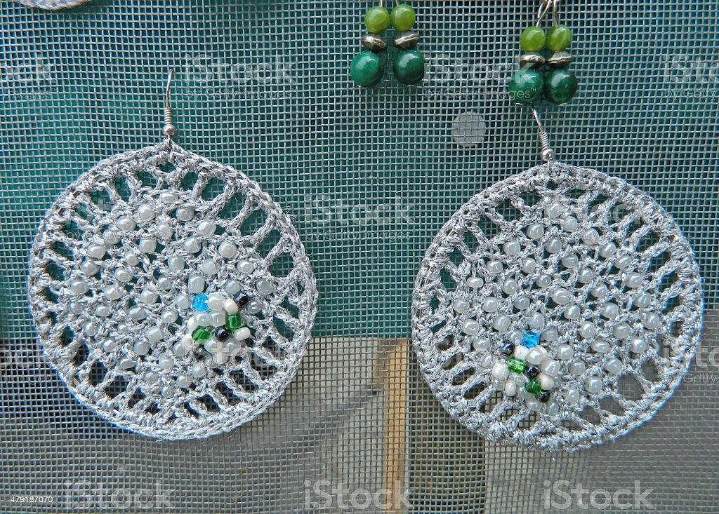 Handmade silver earrings stock photo