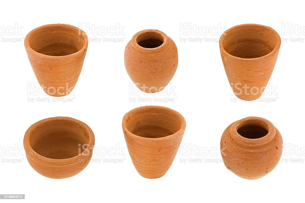 Handmade small round unglazed clay pots in different size, type stock photo