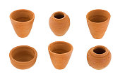 Handmade small round unglazed clay pots in different size, type