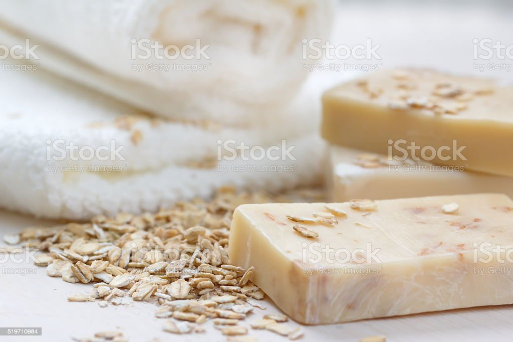 Handmade soap with oat scrub and milk stock photo