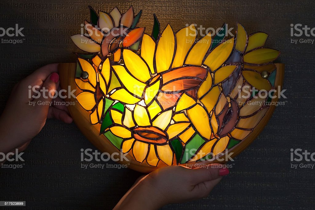 Handmade stained glass lamp with colorful sunflowers stock photo