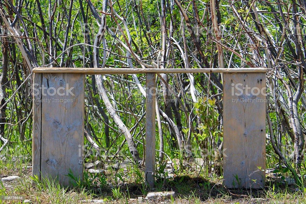 Handmade Wood Bench in Nature Background stock photo