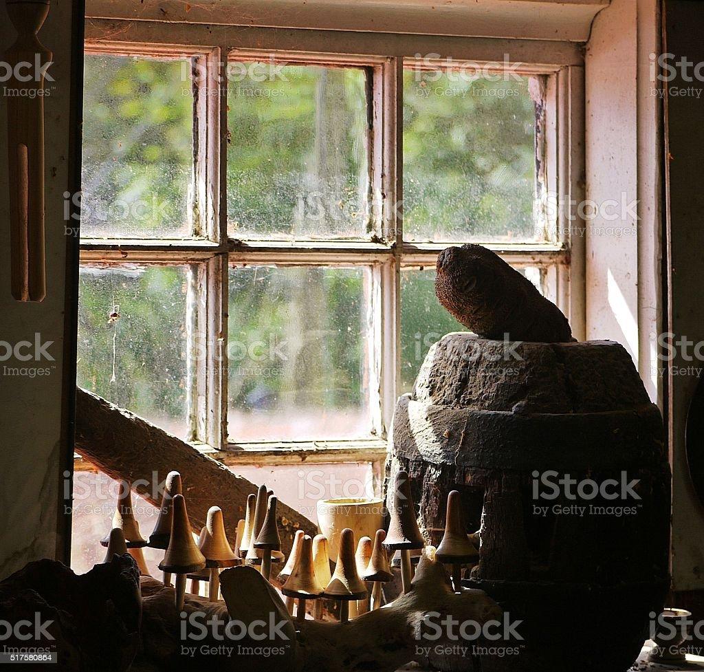 handmade wooden ornaments in sunlit window. stock photo