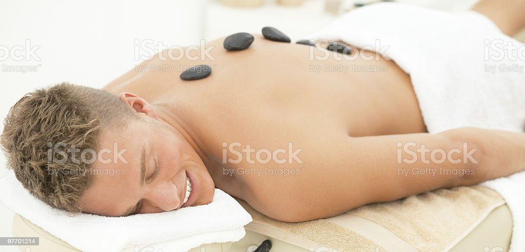 Handome guy getting spa treatment royalty-free stock photo