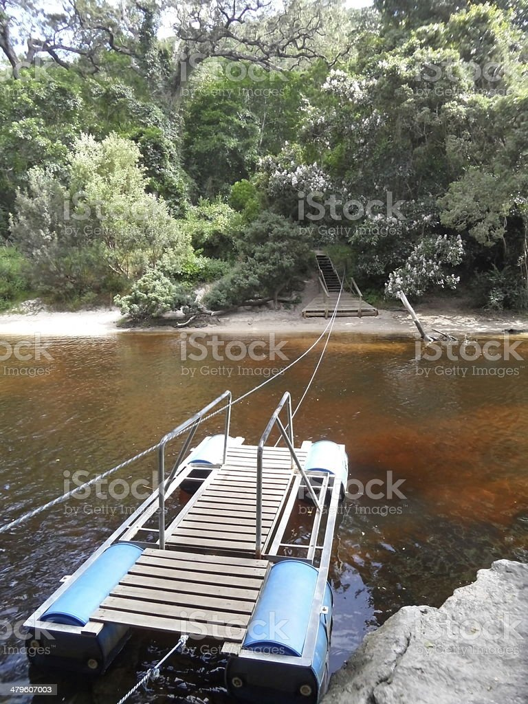 handoperated ponton crossing a river stock photo