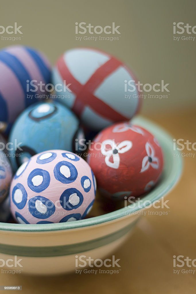 Hand-painted easter eggs in a bowl royalty-free stock photo