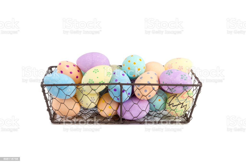Hand-Painted Easter Eggs in Chicken Wire Tray Cut Out stock photo