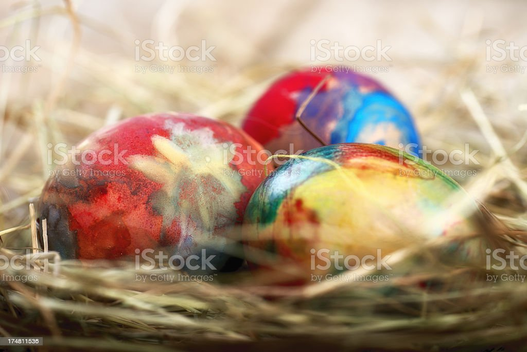 Handpainted easter eggs in hay nest royalty-free stock photo