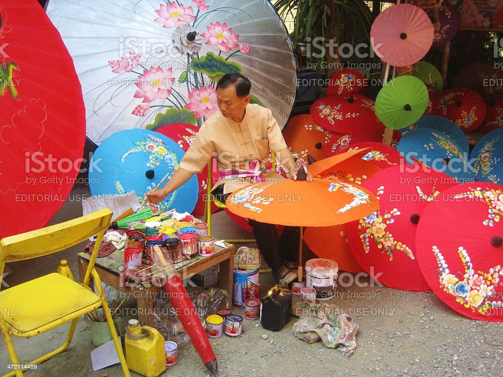 Hand-Painting Umbrellas in Thailand stock photo
