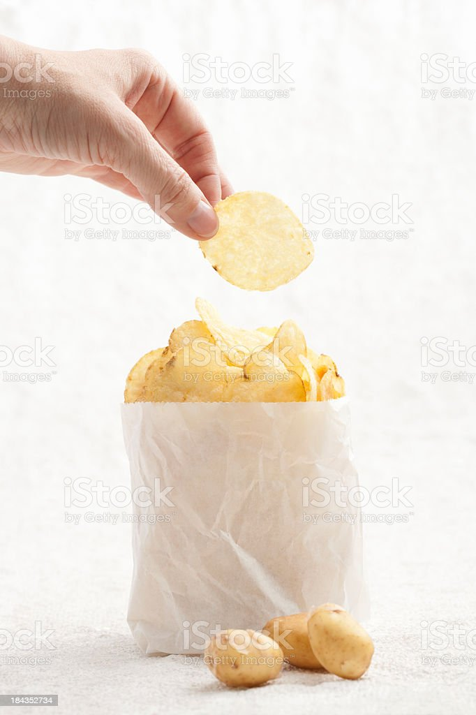 Handpicked potato crisps stock photo