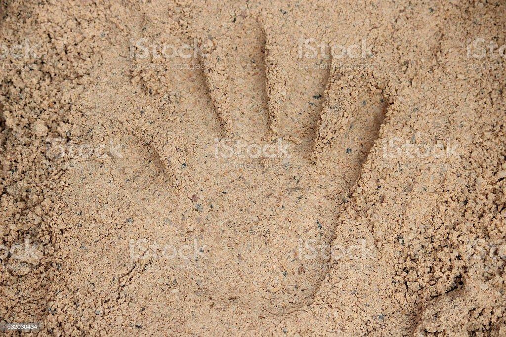 Handprint in sand stock photo