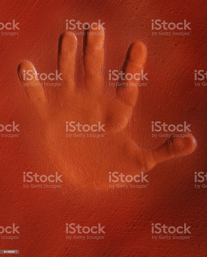 Handprint on red clay royalty-free stock photo