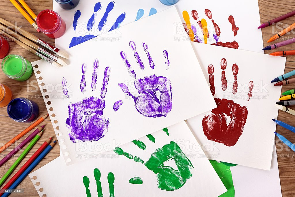 Handprints and art equipment royalty-free stock photo