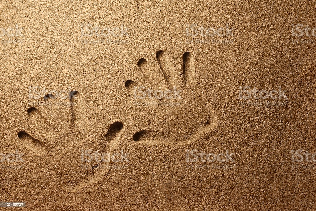 handprints in the sand royalty-free stock photo
