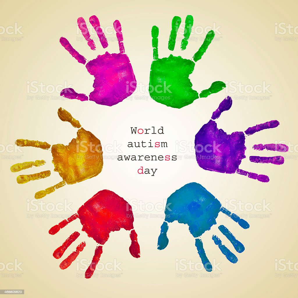 handprints of different colors and text world autism awareness d stock photo
