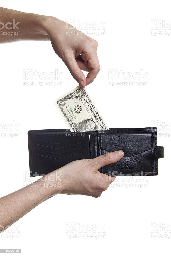 hand-pulling the dollar from purse royalty-free stock photo