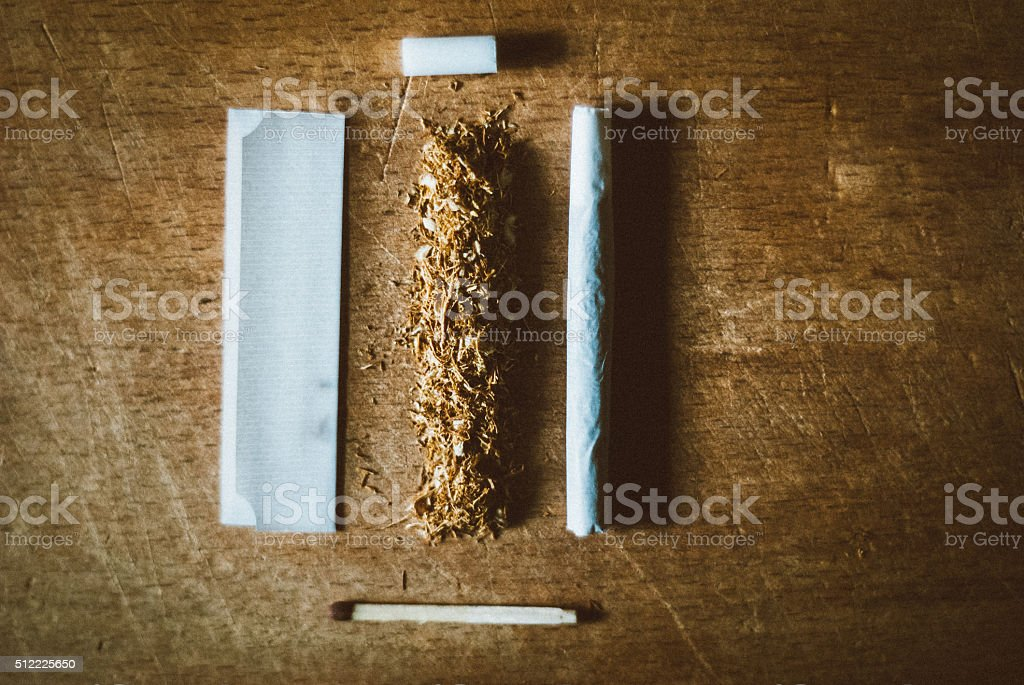 Hand-rolled cigarette stock photo