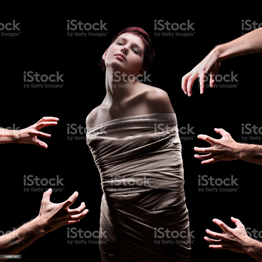 Hands about to grab a female wrapped royalty-free stock photo