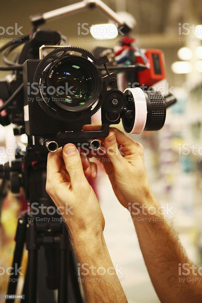Hands Adjusting Camera stock photo