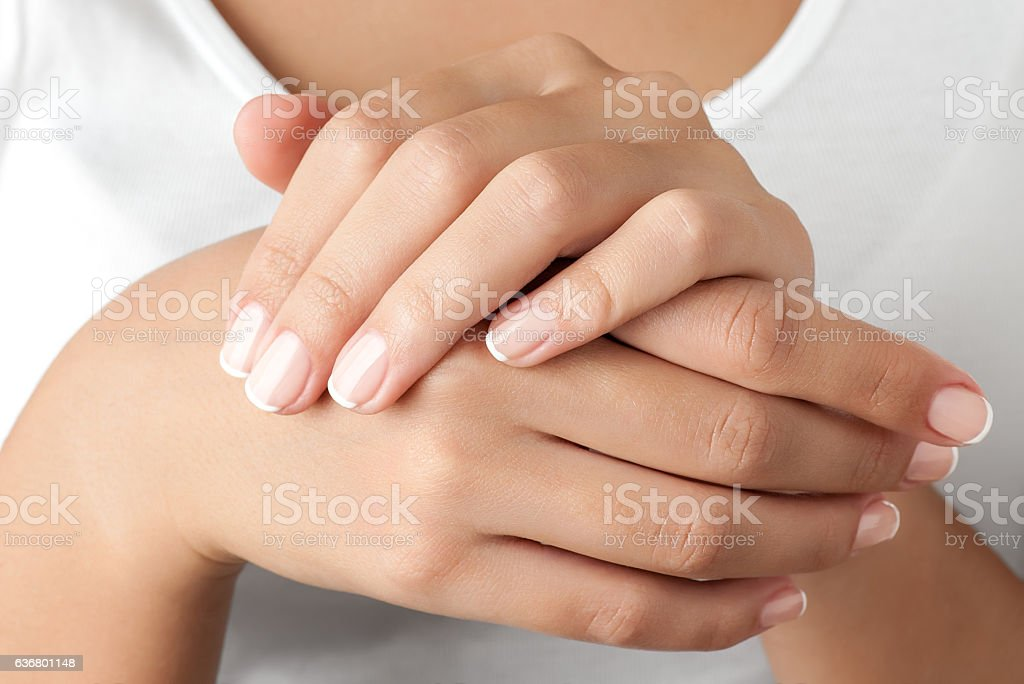 Hands against body stock photo