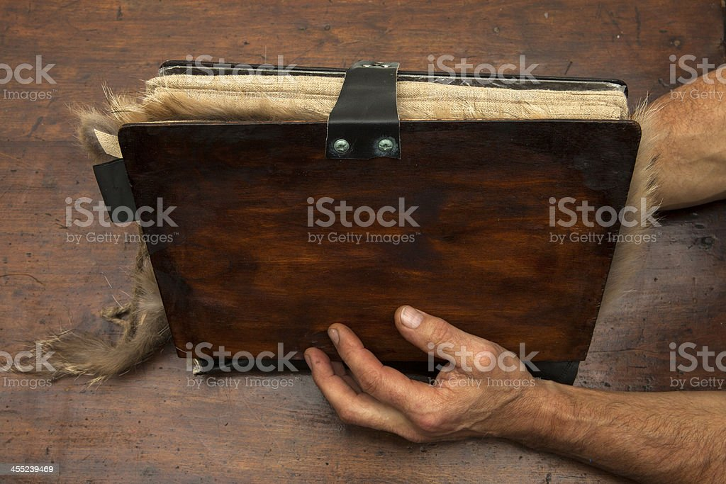 Hands and a strange book stock photo