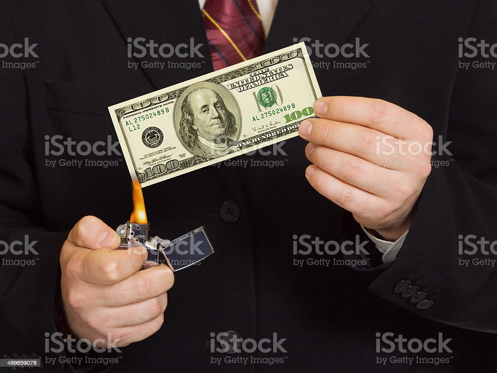 Hands and burnning money stock photo