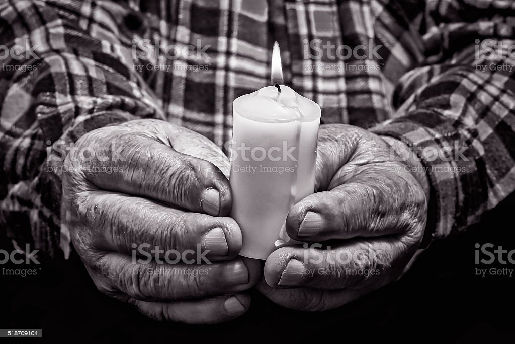 Hands and candle stock photo