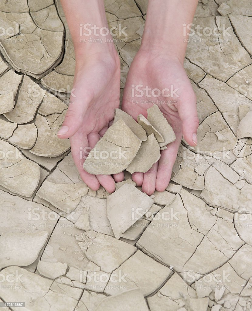 Hands and Cracked Clay royalty-free stock photo